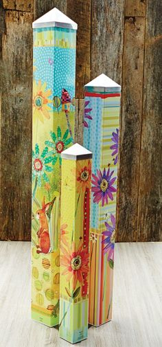 Artist Robbin Rawlings was given three blank poles to tell a story. This Art Pole Garden was the result. Art Poles feature artwork laminated onto a lightweight PVC pole for fade-resistance, durability, & reduced shipping cost. Easy to install. Hardware included. $399.95 at Quirks of Art. This set makes a beautiful gift for someone you love.