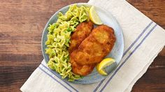 Recipe with video instructions: The classic Austrian dish gets an upgrade with a creamy pesto sauce and scrumptious egg noodles. Ingredients: For the schnitzel:, 8 boneless skinless chicken breast cutlets, pounded to about 1/4-inch thick, 1 tablespoon garlic powder, 2 teaspoons kosher salt, divided, 1/2 cup all-purpose flour, 3 large eggs, beaten, 1 cup fine breadcrumbs, 1 cup canola or vegetable oil, divided, For the noodles:, 1 pound extra-wide egg noodles, 2 tablespoons unsalted ...