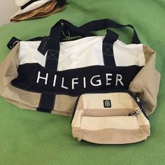 NWT Tommy Hilfiger duffle bag & cosmetic case Duffle is NWT! Tags were removed from case but never used. This is very classic and chic! Khaki, navy and white with traditional TH flag. Beautiful set!  was $65 new! No low offers please, keep in mind this is a new set and I'm already getting less than posted! Tommy Hilfiger Bags Travel Bags