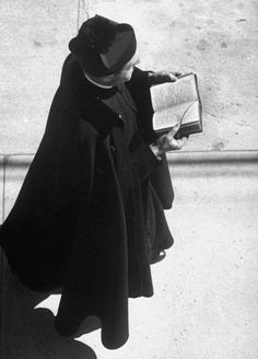 Old photo of a priest praying the breviary