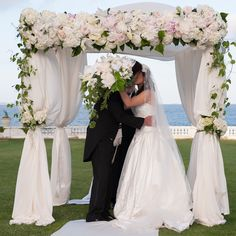 Fabric chuppah and amazing white bouquet of peony,lilies, roses, and clematis vine! Gorgeous photo by (c) M Benedicte Verley Photography