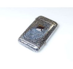 Continental silver and niello work cigarette case, with hinged cover and base section with hinged cover, marked, 3.5 troy oz.