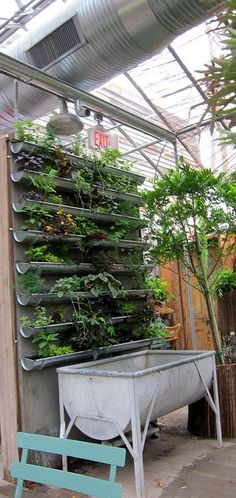 Attach rain gutters to a garden wall to replicate this unique container garden. Again, remember the drainage.