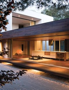 """This Carlsbad home has a tertiary space that space is known in traditional Japanese homes as the """"engawa. To sustain a unified look throughout the floor and ceiling are clad in ipe wood. Photo by Architecture by Sebastian Mariscal Studio by dwellmagazine Architecture Design, Residential Architecture, Modern Japanese Architecture, Japan Architecture, Natural Architecture, California Architecture, Scandinavian Architecture, Architecture Sketchbook, Victorian Architecture"""