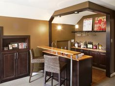 Run My Renovation: A Combination Bar, Game Room and Craft Center: We asked you to pick a fun accessory for the room – either scrapbooking supplies or vintage Rolling Stone magazine covers.  You can see what won the vote on the shelf over the bar.  From DIYnetwork.com
