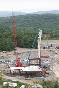 Cranes in action on the concourse on the first base line at PNC Field.