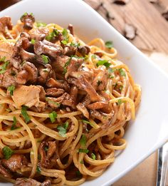 Update basic chicken pasta with garlic, flavorful sautéed mushrooms, white wine, and fresh parsley. Common button mushrooms are great in this recipe, but if you want to amp up the flavor or impress someone special, choose porcini, morel, oyster, or other wild mushrooms for your chicken and mushroom pasta. #pasta #mushrooms #chicken #garlic #recipes