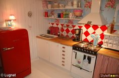 What a beautiful blue and red kitchen