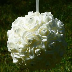 Ivory rose foam pomander ball with diamantes and hanging ribbon. Use thesepretty sparkling rose pomander balls at your wedding venue inside or out to give a softened effect to your decorations. Alternatively,simply carry around as a kissing ball.