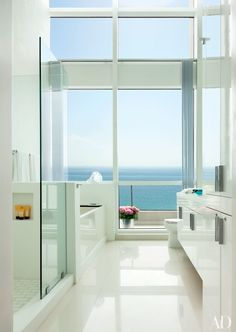 Designer John Barman raised the ceiling in the master bath of his Miami Beach apartment to a soaring 15 feet. He used the same white ceramic floor tiles throughout the interior, with a nonskid version on the terrace, which spans the entire apartment.