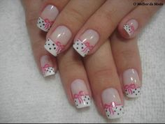 White French tips with small black polka dots and free hand pink ribbons. nail art
