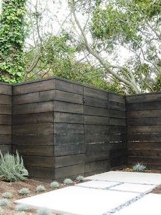 """The wood is 1"""" x 8"""" cedar slats that have been stained with a semi transparent stain, BEHR stain 'Slate', a dark charcoal."""