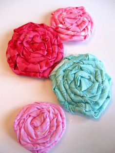 Twisted Fabric Flower Tutorial - I've actually used this one & it's quite good.  Getting the center of the flowers to look good is tricky for me & she has a great explanation here.