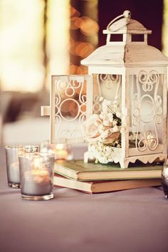 Ivory lantern with books and flowers plus the candles - so romantic