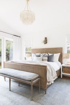 Serene bedroom with white walls, a shell chandelier, and bedding layered with ca. Serene bedroom w White Wall Bedroom, Serene Bedroom, Wood Bedroom, Master Bedroom Design, Bedroom Sets, Modern Bedroom, Bedroom Furniture, Bedroom Decor, Contemporary Bedroom