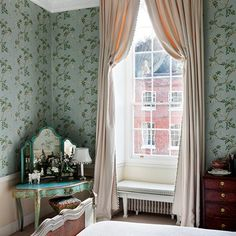 These Italian strung curtains, in the bedroom of a Ludlow townhouse designed by Caroline Harrowby, have a goblet-pleated header design. They are fixed in position at the top and then drawn up and down using a cord. The look is quite traditional and very pretty.