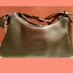 Dooney & Bourke purse Dooney & Bourke purse Brown leather Used purse as seen in pictures ISO Are you in search of this? No trades or returns Dooney & Bourke Bags Shoulder Bags