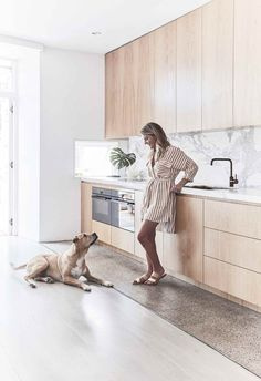 Kitchen: Louisa with her dog Sim. The polished concrete floor was part of the original house and fits in with the updates, and the original spotted gum flooring was sanded, limewashed and revived by Mint Floor Sanding & Finishing. Kitchen Benchtops, Kitchen Cabinetry, Kitchen Splashback Ideas, Soapstone Kitchen, Kitchen Countertops, Modern Kitchen Renovation, Home Renovation, Kitchen Remodelling, Contemporary Kitchen Design