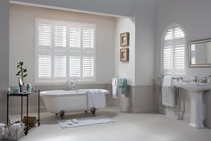 Bathroom with white vinyl plantation shutters