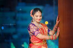 South Indian bride. Gold Indian bridal jewelry.Temple jewelry. Jhumkis. Red silk kanchipuram sari with contrast purple blouse.Braid with fresh jasmine flowers. Tamil bride. Telugu bride. Kannada bride. Hindu bride. Malayalee bride.Kerala bride.South Indian wedding.