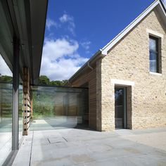 Contemporary glass link to stone farmhouse