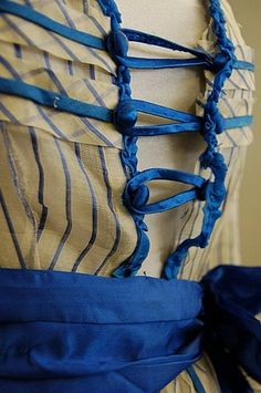 A blue and white striped gauze summer gown, circa the bodice with square neckline, flounced sleeves, peplum trimmed with blue satin, blue ribbon belt with later added bow. Victorian Gown, Victorian Steampunk, Victorian Fashion, Historical Women, Historical Clothing, Summer Gowns, Civil War Dress, Old Dresses, Fantasy Costumes