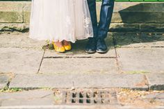 Vintage Bride & Groom's wedding shoes, on cobbled street in Saltaire, Leeds, West Yorkshire.