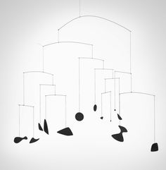 Alexander Calder | Mobile consisting of 11 wire rods suspended horizontally, with 13 black-painted sheet steel elements in abstract shapes suspended from painted linen cords.
