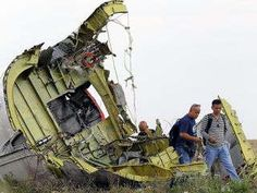 Cockpit of MH 17 found sawed in half at crash site
