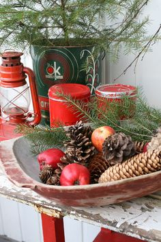 Get unique bowls from your local Goodwill and fill them with holiday items like pinecones, apples, and greens!