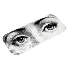 Bring distinctive style to your kitchen with this Occhi tray from Fornasetti. Beautifully crafted from solid wood it depicts the eyes of Piero Fornasetti's favourite muse, opera singer Lina Cavalier