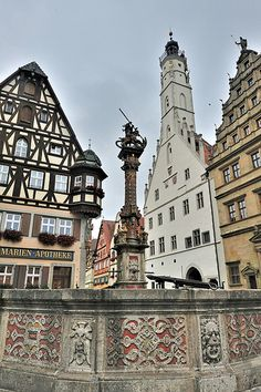 the fountain in the square of Rothenburg Germany Visit Germany, Germany Travel, Germany Ww2, Places Around The World, Around The Worlds, Rothenburg Germany, History Of Germany, German Architecture, Rothenburg Ob Der Tauber