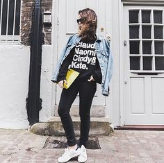 A Black Graphic T-Shirt, Black Pants, a Denim Jacket, and Sneakers | 80 Outfits to Try When You