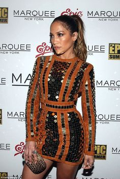 Glamorous: JLo wore her long locks pulled back from her face in a high ponytail…
