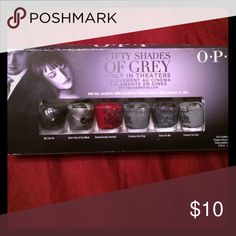 OPI mini set 50 Shades of Grey OPI mini gift set, 6 bottles, only Cement the Deal and Dark Side of the Mood used (once each) OPI Makeup