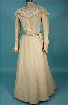As the Edwardian era progressed, the high necks got lower and the silhouette became simpler and less full. Edwardian wedding gown with a simpler silhouette