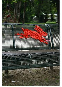 Cross-stitch yarn bombing! I want to do this!