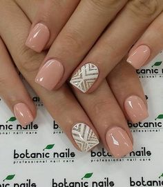 Nude and white winter nail art combination. The beautiful thing about nude is you can pair almost anything with it. Go classy and choose white with a sprinkle of gold glitter everywhere.: