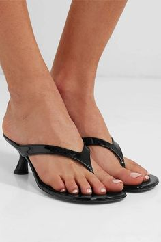 women wearing high heeled shoes