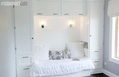 Built-in Reading Nook  pull-out to queen bed with storage underneath.   http://thesawdustdiaries.com/built-in-reading-nook/