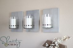 Wall sconce - these would be pretty with something stenciled on the wood.  #DIY