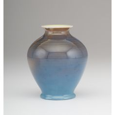 Rookwood Pottery Vase, Ruben Menzel. American (Cincinnati, Ohio), 1953. A Rookwood Pottery vase in a blue over green gradiant glaze, decorated by Ruben Earl Menzel, with factory and date mark to underside, along with S, artist's initials and spiral mark; ht. 5.75 in.