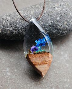 This statement necklace is a fusion of wood, stone, moss and real flowers in resin. It looks like miniature fantasy forest landscape. We use only high quality epoxy resin, and the wood was treated with special oils. The Pendant is UV and Water resistant. Cotton cord 85cm Pendant #jewelrynecklaces
