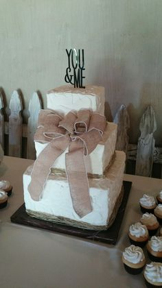 3 Tier Square flush rustic wedding cake with twine around base of each tier and burlap ribbon.