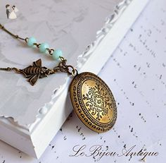 Bee locket necklace in antique bronze with Moroccan carvings and blue crystals Prom Botanical jewelry - Wedding nacklaces (*Amazon Partner-Link)