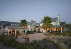 Maybe a trip to the Larkmead Vineyard is in order to check this place out.  Howard J. Backen, architect.