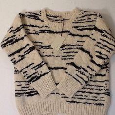 "New IRO Lexi sweater Merino Wool Incredibly soft 100% merino Wool sweater by IRO. Ecru and black pattern. 19"" across laying flat. 21"" long from back collar to hem. 17"" sleeve length. Size 0. Retail $406. IRO Sweaters Crew & Scoop Necks"
