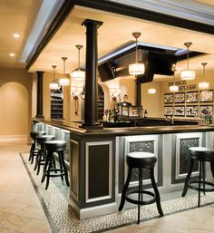 Check out the layers of light in this pub space: recessed ceiling lights, neon crown molding accents, hanging fixtures above the bar and undermounted lights below, and wall sconces near the wine room. This room's ready for drama. #housetrends
