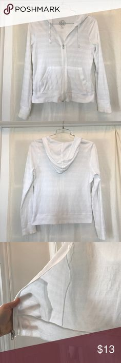 Super cute white zip up hoodie! Size M. This is a really great zip up hoodie perfect for spring days and summer nights. Nice and thin, and really flattering. It fits like a snug large, more like a medium. Tops Sweatshirts & Hoodies