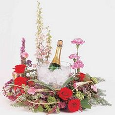 See stunning pics of centerpieces and bridal bouquets, learn how to make your own wedding flowers with easy tutorials and more. Edible Centerpieces, Wine Bottle Centerpieces, Edible Bouquets, Wine Bottles, Bridal Bouquets, Tulle Decorations, Wedding Decorations, Diy Wedding Flowers, Wedding Ideas